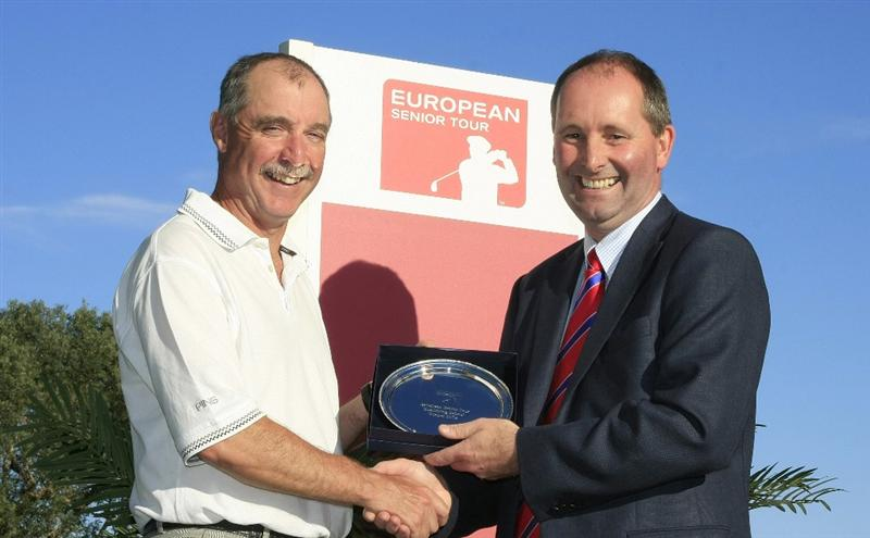 PORTIMAO, PORTUGAL - NOVEMBER 20:  Jimmy Heggarty of Northern Ireland receives the EST Qualifying School Winners Salver from Andy Stubbs, Managing Director of the European Senior Tour, following the final round of the EST Qualifying School Finals played at Vale da Pinta Pestana Golf Resort on November 20, 2008 in Portimao, Portugal  (Photo by Phil Inglis/Getty Images)