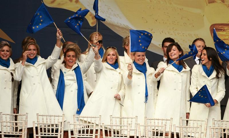 NEWPORT, WALES - SEPTEMBER 30:  The European Wives and Girlfriends wave flags during the Opening Ceremony prior to the 2010 Ryder Cup at the Celtic Manor Resort on September 30, 2010 in Newport, Wales.  (Photo by Andrew Redington/Getty Images)