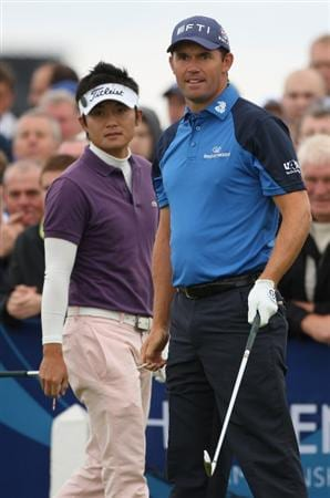 TURNBERRY, SCOTLAND - JULY 18:  Padraig Harrington of Ireland looks down the 1st hole with Ryuji Imada of Japan during round three of the 138th Open Championship on the Ailsa Course, Turnberry Golf Club on July 18, 2009 in Turnberry, Scotland.  (Photo by Andrew Redington/Getty Images)