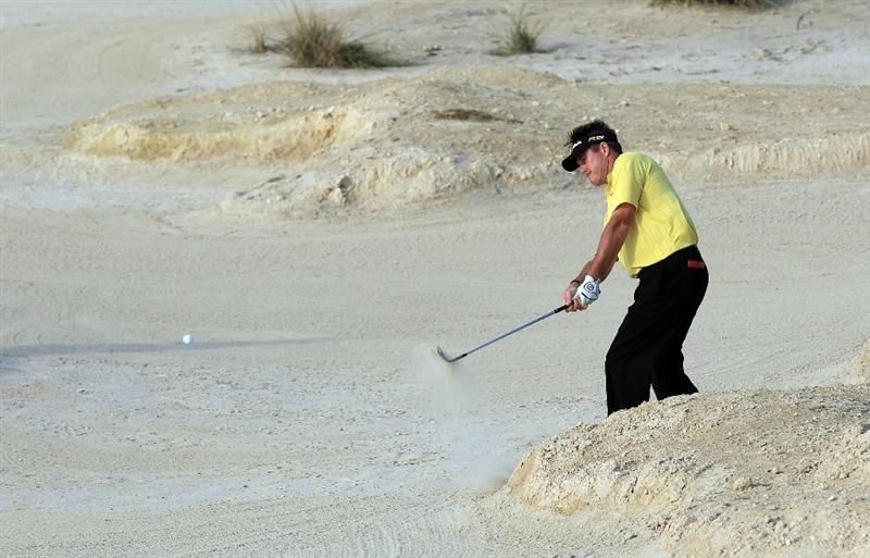 BAHRAIN, BAHRAIN - JANUARY 30:  Todd Hamilton of the USA plays his second shot at the 18th hole during the final round of the 2011 Volvo Champions held at the Royal Golf Club on January 30, 2011 in Bahrain, Bahrain.  (Photo by David Cannon/Getty Images)