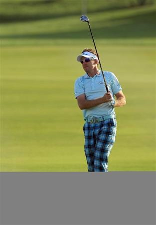 ABU DHABI, UNITED ARAB EMIRATES - JANUARY 21:  Ian Poulter of England watches his sewcond shot at the par 5, 18th hole during the first round of The Abu Dhabi Golf Championship at Abu Dhabi Golf Club on January 21, 2010 in Abu Dhabi, United Arab Emirates.  (Photo by David Cannon/Getty Images)