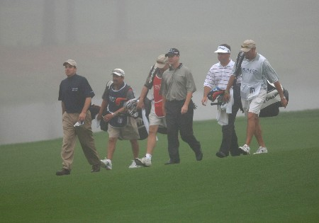 The Matt Gogel, Joe Ogilvie and Brian Bateman group walk up a foggy fairway during the second round of THE PLAYERS Championship at the Tournament Players Club at Sawgrass in Ponte Vedra Beach, Florida on March 26, 2005.