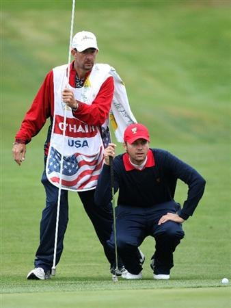 SAN FRANCISCO - OCTOBER 11:  Sean O'Hair of the USA Team lines up a putt with his caddie Paul Tesori on the first hole during the Final Round Singles Matches of The Presidents Cup at Harding Park Golf Course on October 11, 2009 in San Francisco, California.  (Photo by David Cannon/Getty Images)