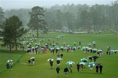 AUGUSTA, GA - APRIL 12:  Patrons walk with their umbrellas during the third round of the 2008 Masters Tournament at Augusta National Golf Club on April 12, 2008 in Augusta, Georgia.  (Photo by Harry How/Getty Images)