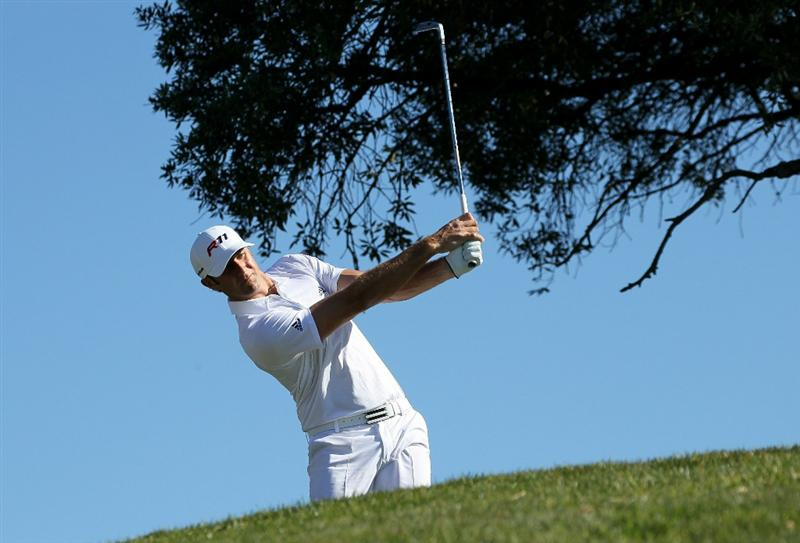 LA JOLLA, CA - JANUARY 27:  Dustin Johnson hits his tee shot on the third hole during round one of the Farmers Insurance Open at Torrey Pines North Course on January 27, 2011 in La Jolla, California.  (Photo by Stephen Dunn/Getty Images)