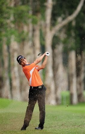 HONG KONG - NOVEMBER 12:  Wen-chong Liang of China plays his approach shot on the seventh hole during the first round of the UBS Hong Kong Open at the Hong Kong Golf Club on November 12, 2009 in Fanling, Hong Kong.  (Photo by Stuart Franklin/Getty Images)