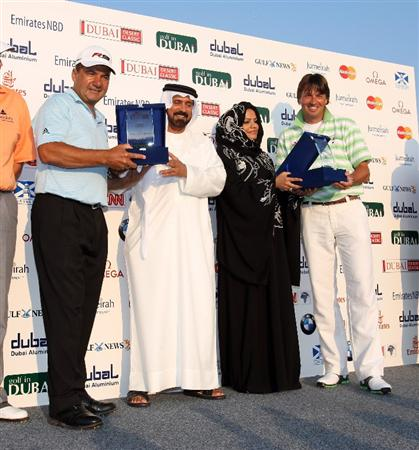 DUBAI, UNITED ARAB EMIRATES - JANUARY 27:  Robert Jan Derksen of Holland (right) and Jose Coceres of Argentina (left) recieve their winners prizes from Mohamed Juma Buamaim the Vice-Chairman and CEO of Golf in Dubai and Moza Bint Hamad from Leisurecorp, the owners of Turnberry in Scotland, during the Challenge Match on the Par 3 Course at the Emirates Golf Club on January 27, 2009 in Dubai, United Arab Emirates  (Photo by David Cannon/Getty Images)