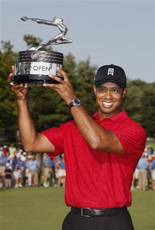 GRAND BLANC, MI - AUGUST 02:  Tiger Woods holds up the trophy after winning the 2009 Buick Open at Warwick Hills Golf and Country Club on August 2, 2009 in Grand Blanc, Michigan.  (Photo by Gregory Shamus/Getty Images)