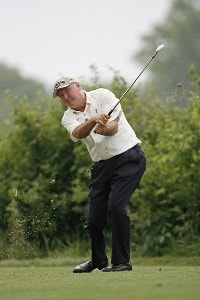 Allen Doyle watches a tee shot on hole 4 during the final round of the U.S. Senior Open at Prairie Dunes Country Club in Hutchinson,  Kansas on July 9, 2006.Photo by G. Newman Lowrance/WireImage.com