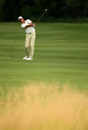 SUN CITY, SOUTH AFRICA - DECEMBER 06:  Robert Karlsson of Sweden plays into the 15th green during the third round of the Nedbank Golf Challenge at the Gary Player Country Club on December 6, 2008 in Sun City, South Africa.  (Photo by Richard Heathcote/Getty Images)