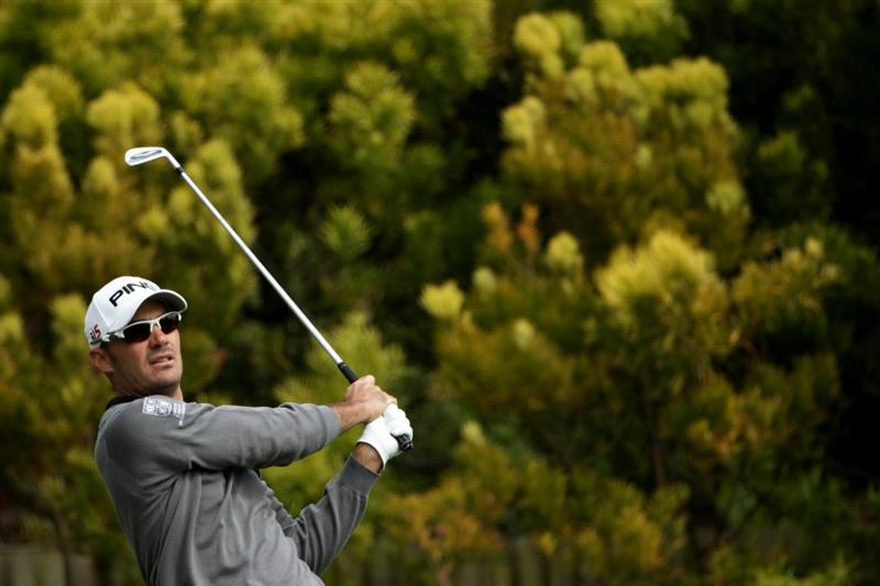 PEBBLE BEACH, CA - JUNE 20:  Gregory Havret of France watches his tee shot on the 12th hole during the final round of the 110th U.S. Open at Pebble Beach Golf Links on June 20, 2010 in Pebble Beach, California.  (Photo by Andrew Redington/Getty Images)