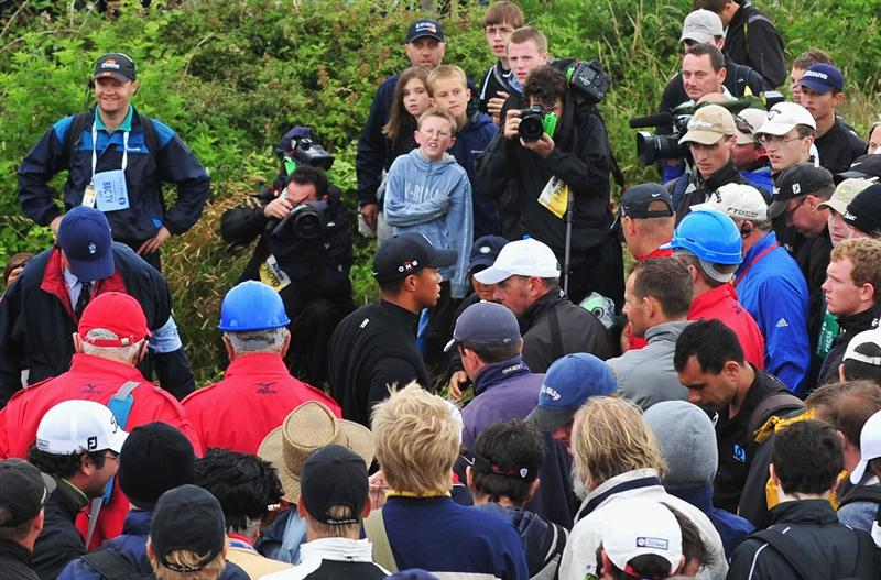 TURNBERRY, SCOTLAND - JULY 17:  Tiger Woods of USA searches with fans for his golf ball on the the tenth hole during round two of the 138th Open Championship on the Ailsa Course, Turnberry Golf Club on July 17, 2009 in Turnberry, Scotland.  (Photo by Stuart Franklin/Getty Images)
