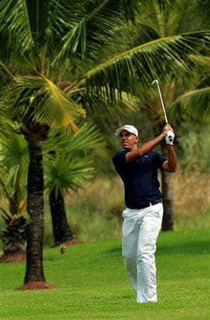 CHON BURI, THAILAND - FEBRUARY 24:  Kunal Bhasin of Australia plays his 2nd shot on the 6th hole during day one of The Open Championship Asia Final Qualifying tournament at Amata Spring Country Club on February 24, 2011 in Chon Buri, Thailand.  (Photo by Stanley Chou/Getty Images)