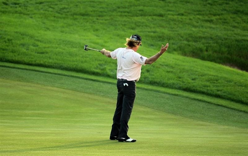 BAHRAIN, BAHRAIN - JANUARY 30:  Miguel Angel Jimenez of Spain birdies the 18th hole during the final round of the 2011 Volvo Champions held at the Royal Golf Club on January 30, 2011 in Bahrain, Bahrain.  (Photo by David Cannon/Getty Images)