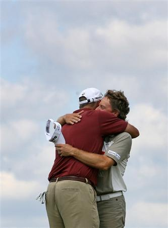 SAVANNAH, GA : Tom Lehman (L) hugs playing partner Bernhard Langer (R) of Germany after they made par on the second playoff hole to win the Liberty Mutual Legends of Golf at the Westin Savannah Harbor Golf Resort and Spa on April 26, 2009 in Savannah, Georgia. (Photo by Hunter Martin/Getty Images)