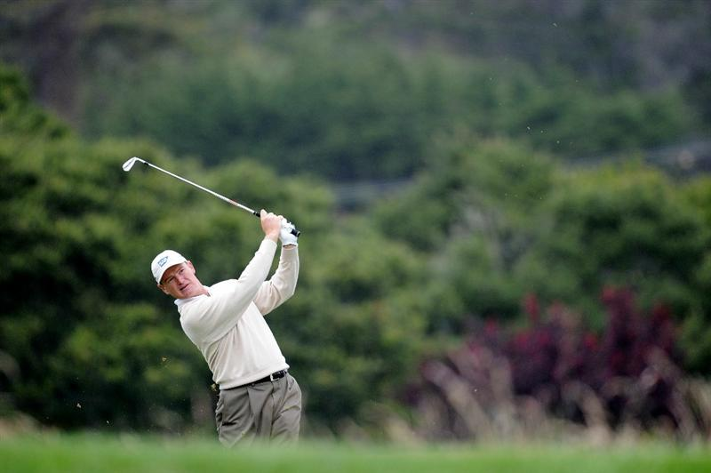 PEBBLE BEACH, CA - JUNE 18:  Ernie Els of South Africa hits his approach shot on the 16th hole during the second round of the 110th U.S. Open at Pebble Beach Golf Links on June 18, 2010 in Pebble Beach, California.  (Photo by Harry How/Getty Images)