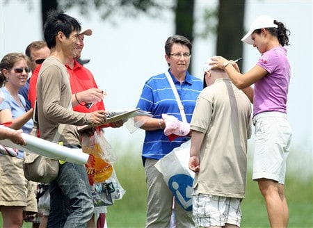 HAVRE DE GRACE, MD - JUNE 04:  Lorena Ochoa (R) of Mexico signs autographs at the tee on the second hole during practice for the 2008 McDonald's LPGA Championship held at Bulle Rock Golf Course, on June 4, 2008 in Havre de Grace, Maryland.  (Photo by David Cannon/Getty Images)