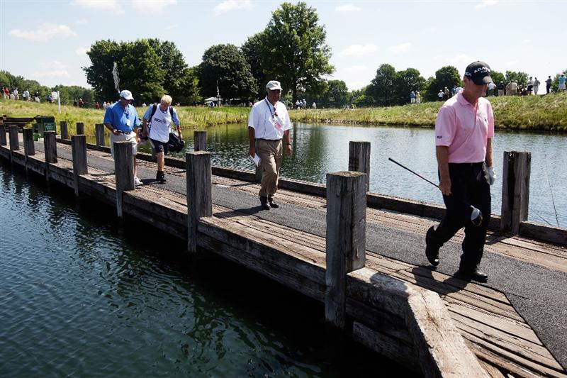 CARMEL, IN - JULY 31:  Tom Watson of the USA crosses a bridge on the 4th hole during the second round of the 2009 U.S. Senior Open on July 31, 2009 at Crooked Stick Golf Club in Carmel, Indiana.  (Photo by Jamie Squire/Getty Images)