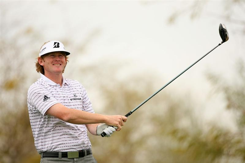 SCOTTSDALE, AZ - FEBRUARY 27: Brandt Snedeker watches his tee shot on the ninth hole during the third round of the Waste Management Phoenix Open at TPC Scottsdale on February 27, 2010 in Scottsdale, Arizona. (Photo by Hunter Martin/Getty Images)