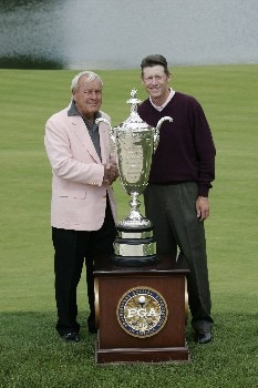 Mike Reid with Arnold Palmer and the Senior PGA trophy at #18 after  the final round of the 2005 Senior PGA Championship at Laurel Valley Golf Club - Ligonier, Pennsylvania. May 29, 2005Photo by Christopher Condon/WireImage.com