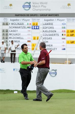CASARES, SPAIN - MAY 20:  Victor Francesco Molinari of Italy shakes hands with Paul Lawrie on the 16th green during the group stages of the Volvo World Match Play Championships at Finca Cortesin on May 20, 2011 in Casares, Spain.  (Photo by Warren Little/Getty Images)