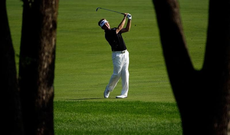 CHASKA, MN - AUGUST 14:  David Toms hits a shot on the 11th hole during the second round of the 91st PGA Championship at Hazeltine National Golf Club on August 14, 2009 in Chaska, Minnesota.  (Photo by Jamie Squire/Getty Images)