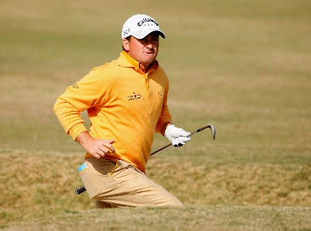 NEW DELHI, INDIA - FEBRUARY 09:  Graeme McDowell of Northern Ireland runs after his bunker shot on the eighth hole during the third round of the Emaar-MGF Indian Masters at the Delhi Golf Club on February 9, 2008 in Delhi, India.  (Photo by Stuart Franklin/Getty Images)