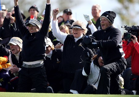 HALMSTAD, SWEDEN - SEPTEMBER 15:  (L-R) Sophie Gustafson, Laura Davies of England and Suzann Pettersen of Norway, all of the European Team, celebrate a victory in the final match of the morning foursome matches of the 2007 Solheim Cup the Halmstad Golf Club September 15, 2007 in Halmstad, Sweden.  (Photo by Andy Lyons/Getty Images)