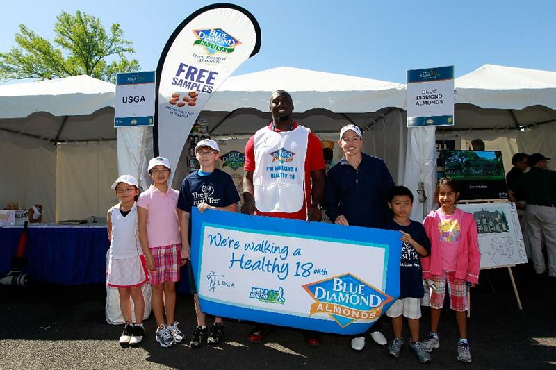 GLADSTONE, NJ - MAY 21: NFL player Muhammad Wilkerson of the New York Jets joins LPGA player Stephanie Louden and local junior golfers to support Blue Diamond Almonds 'Walk A Healthy 18' program at the Sybase Match Play Championship at Hamilton Farm Golf Club on May 21, 2011 in Gladstone, New Jersey.  (Photo by Chris Trotman/Getty Images)
