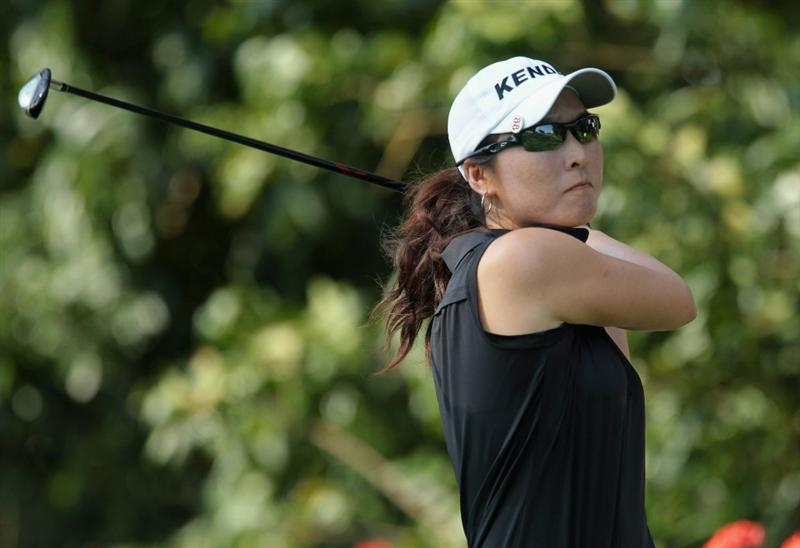 SINGAPORE - FEBRUARY 25:  Candie Kung of Taiwan watches a shot on the 14th hole during the second round of the HSBC Women's Champions 2011 at the Tanah Merah Country Club on February 25, 2011 in Singapore, Singapore.  (Photo by Scott Halleran/Getty Images)