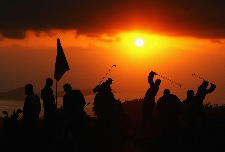 MADEIRA, PORTUGAL - MARCH 22:  Golfers warm up on the practice range at sunrise during Round Three of the Madeira Islands Open BPI 2008 at Clube De Golf Santo Da Serra on March 22, 2008 in Madeira, Portugal.  (Photo by Ryan Pierse/Getty Images)
