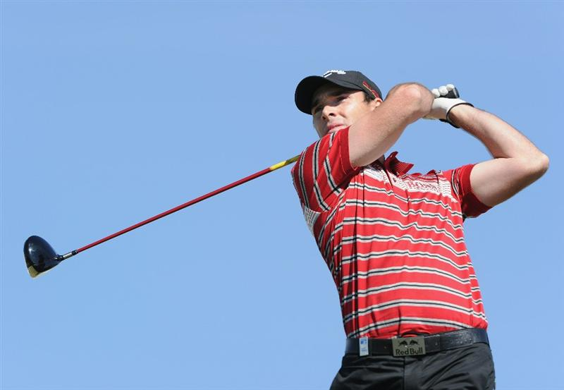 VILAMOURA, PORTUGAL - OCTOBER 17:  Oliver Wilson of England plays his tee shot on the first hole during the final round of the Portugal Masters at the Oceanico Victoria Golf Course on October 17, 2010 in Vilamoura, Portugal.  (Photo by Stuart Franklin/Getty Images)