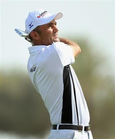 DOHA, QATAR - FEBRUARY 05:  Markus Brier of Austria hits his second shot on the seventh hole during the third round of the Commercialbank Qatar Masters held at Doha Golf Club on February 5, 2011 in Doha, Qatar.  (Photo by Andrew Redington/Getty Images)