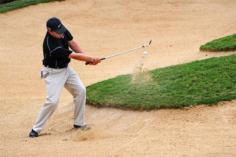 SAN ANTONIO, TX - OCTOBER 11: Justin Leonard blasts out of the greenside bunker on the par three 17th hole during the third round of the Valero Texas Open  held at La Cantera Golf Club on October 11, 2008 in San Antonio, Texas.  (Photo by Marc Feldman/Getty Images)