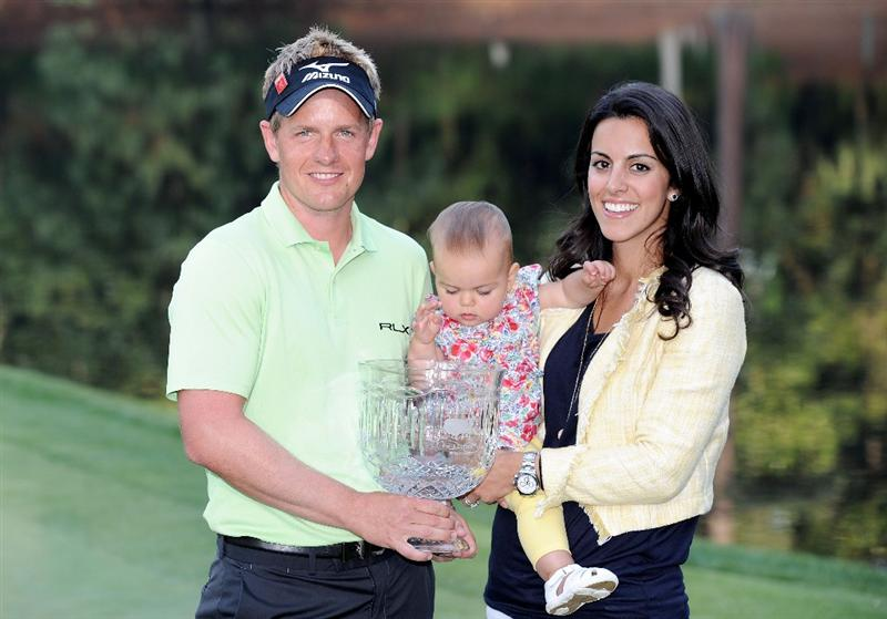 AUGUSTA, GA - APRIL 06:  Luke Donald of England poses with the trophy and his wife Diane and daughter Elle after his score of five-under par won the Par 3 Contest prior to the 2011 Masters Tournament at Augusta National Golf Club on April 6, 2011 in Augusta, Georgia.  (Photo by Harry How/Getty Images)