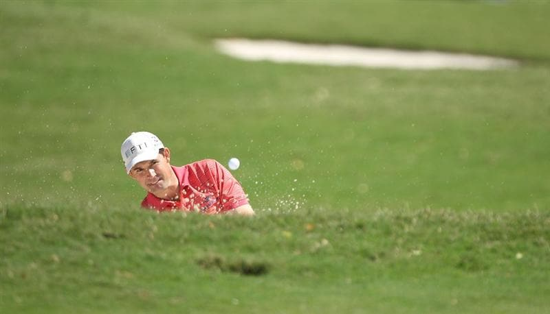 DORAL, FL - MARCH 13:  Padraig Harrington of Ireland hits out of the bunker on the first hole during round three of the 2010 WGC-CA Championship at the TPC Blue Monster at Doral on March 13, 2010 in Doral, Florida.  (Photo by Scott Halleran/Getty Images)