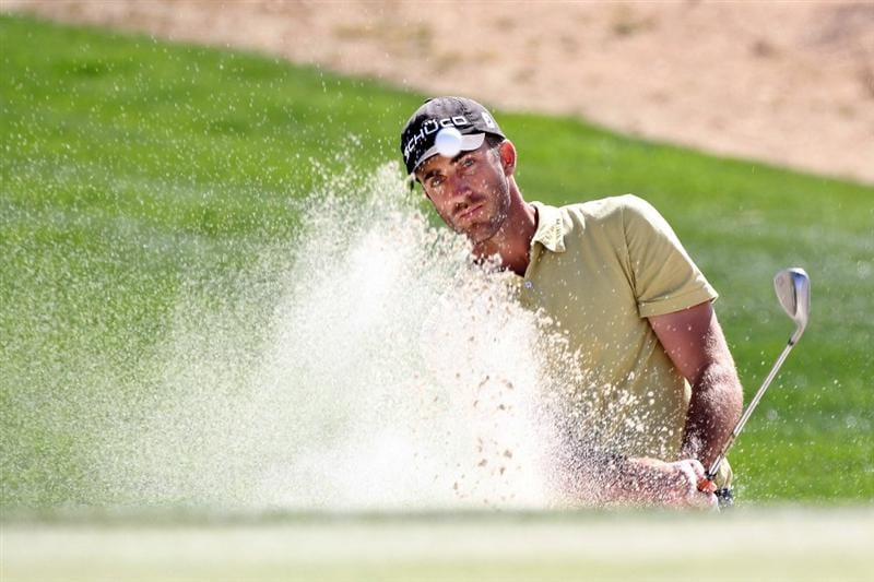MARANA, AZ - FEBRUARY 25:  Geoff Ogilvy of Australia hits from a bunker on the 14th hole during the third round of the Accenture Match Play Championship at the Ritz-Carlton Golf Club on February 25, 2011 in Marana, Arizona.  (Photo by Sam Greenwood/Getty Images)
