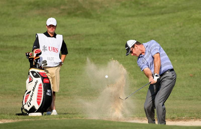 HONG KONG, CHINA - NOVEMBER 21:  Nick Faldo of England plays his bunker shot on the 13th hole during the second round of the UBS Hong Kong Open at the Hong Kong Golf Club on November 21, 2008 in Fanling, Hong Kong.  (Photo by Stuart Franklin/Getty Images)