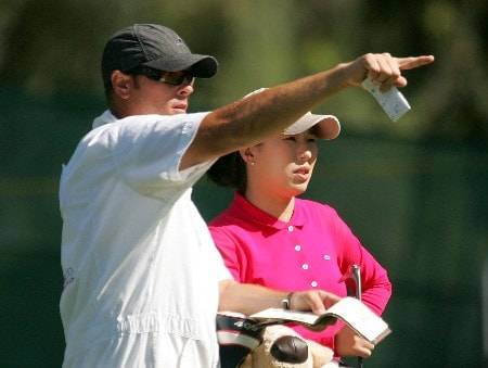 RANCHO MIRAGE, CALIFORNIA - MARCH 29:  Shi Hyun Ahn of South Korea chats with her caddie on the tenth hole during the first round of the Kraft Nabisco Championship at Mission Hills Country Club on March 29, 2007 in Rancho Mirage, California.  (Photo by Scott Halleran/Getty Images)