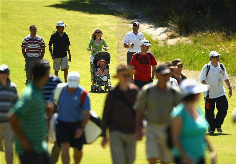 MELBOURNE, AUSTRALIA - NOVEMBER 09: Sergio Garcia of Spain walks down the fairway with the gallery during a practice round during day four of the Australian Masters at The Victoria Golf Club on November 9, 2010 in Melbourne, Australia.  (Photo by Ryan Pierse/Getty Images)