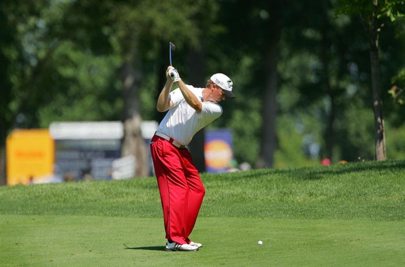 SILVIS, IL - JULY 11:  Tim Petrovic of the USA plays a shot from the fairway during the continuation of the second round of the John Deere Classic at TPC Deere Run held on July 11, 2009 in Silvis, Illinois.  (Photo by Michael Cohen/Getty Images)