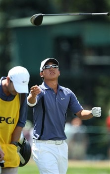 BLOOMFIELD HILLS, MI - AUGUST 09: Anthony Kim tosses his club in the air after playing his sixth tee shot  during round three of the 90th PGA Championship at Oakland Hills Country Club on August 9, 2008 in Bloomfield Township, Michigan.  (Photo by David Cannon/Getty Images)