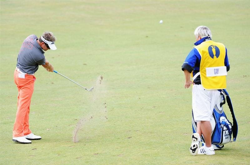 TURNBERRY, SCOTLAND - JULY 16:  Brian Gay of USA hits a shot as his caddie looks on during round one of the 138th Open Championship on the Ailsa Course, Turnberry Golf Club on July 16, 2009 in Turnberry, Scotland.  (Photo by Harry How/Getty Images)