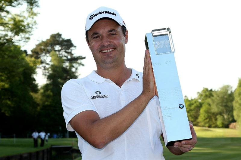 VIRGINIA WATER, ENGLAND - MAY 23:  Simon Khan of England poses with the trophy following his victory at the end of the final round of the BMW PGA Championship on the West Course at Wentworth on May 23, 2010 in Virginia Water, England.  (Photo by Andrew Redington/Getty Images)