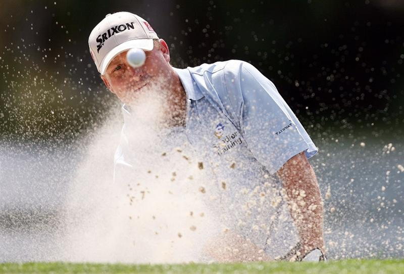 PALM BEACH GARDENS, FL - MARCH 08:  John Rollins hits out of the greenside bunker on the sixth hole during the final round of The Honda Classic at PGA National Resort and Spa on March 8, 2009 in Palm Beach Gardens, Florida.  (Photo by Doug Benc/Getty Images)