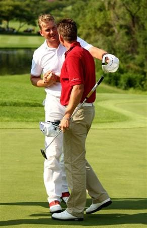 SUN CITY, SOUTH AFRICA - DECEMBER 07:  Robert Karlsson congratulates fellow Swede Henrik Stenson on victory during the final round of the Nedbank Golf Challenge at the Gary Player Country Club on December 7, 2008 in Sun City, South Africa.  (Photo by Richard Heathcote/Getty Images)