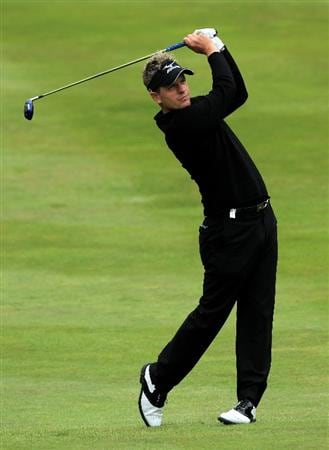 VIRGINIA WATER, ENGLAND - MAY 28:  Luke Donald of England hits his 2nd shot on the 4th hole during the third round of the BMW PGA Championship at the Wentworth Club on May 28, 2011 in Virginia Water, England.  (Photo by David Cannon/Getty Images)