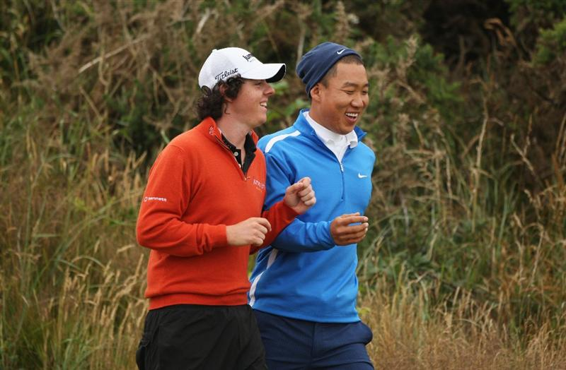 TURNBERRY, SCOTLAND - JULY 17:  Rory McIlroy (L) of Northern Ireland has a laugh with Anthony Kim of USA during round two of the 138th Open Championship on the Ailsa Course, Turnberry Golf Club on July 17, 2009 in Turnberry, Scotland.  (Photo by Warren Little/Getty Images)