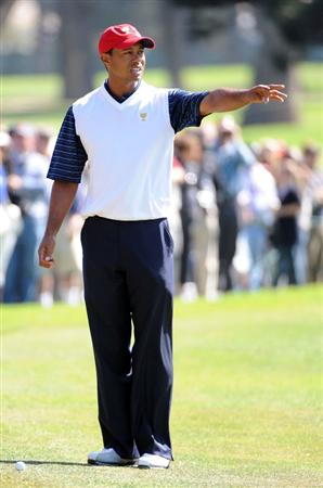SAN FRANCISCO - OCTOBER 09:  Tiger Woods of the USA Team lines up his shot on the seventh hole during the Day Two Fourball Matches of The Presidents Cup at Harding Park Golf Course on October 9, 2009 in San Francisco, California.  (Photo by Harry How/Getty Images)