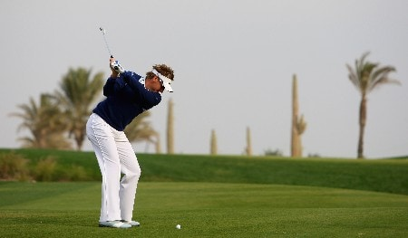 DOHA, QATAR - JANUARY 25:  Ian Poulter of England hits his third shot on the tenth hole during the second round of the Commercialbank Qatar Masters at Doha Golf Club on January 25, 2008 in Doha, Qatar.  (Photo by Andrew Redington/Getty Images)